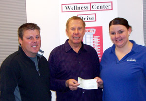 1000 dollar donation to Glidden Wellness Center - John McLaughlin, Mike McLaughlin, Jessica Burns
