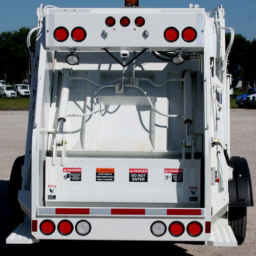 New Way's Diamondback™ Rear Loader design increases efficiency and ease of use for operators.