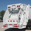 Rear Right Side View of a White New Way Diamondback Rear Loader
