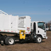 Rear Side View of a New Way Mamba Satellite Side Loader in action