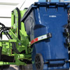 The New Way Sidewinder XTR Automated Side Loader's arm in action